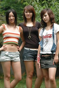 3 sexy asian teens posing outside